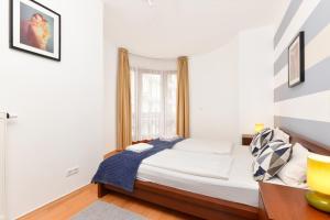 Postel nebo postele na pokoji v ubytování Lord Residence