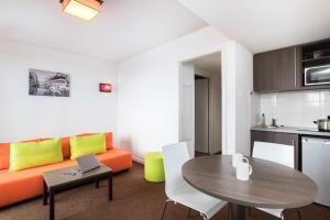 A seating area at Aparthotel Adagio Access Strasbourg Petite France
