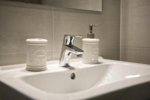 Ванная комната в Cosy Rosie's Apartment