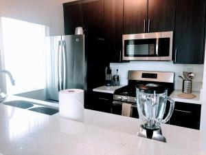 A kitchen or kitchenette at Executive Apartments in Westwood LA