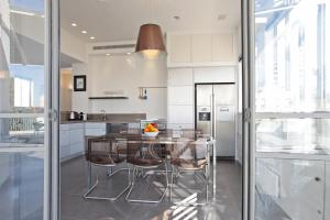 A kitchen or kitchenette at Holiday Rentals TLV-Sea Side
