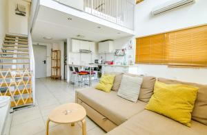 A seating area at Holiday Rentals TLV-Sea Side