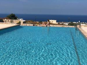 The swimming pool at or near Fira Blue Horizon