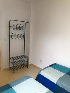 Кровать или кровати в номере Castle Apartment