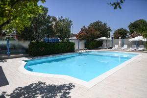 The swimming pool at or near Residence Gambrinus