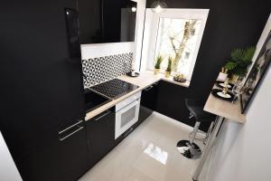 Küche/Küchenzeile in der Unterkunft M11 Outstanding Apartment with Balcony