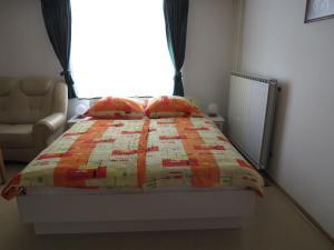 Postelja oz. postelje v sobi nastanitve D-D