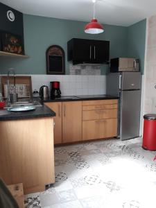 Cuisine ou kitchenette dans l'établissement La cordonnerie