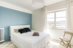 A bed or beds in a room at NICE Cimiez beautiful apartment SEA VIEW