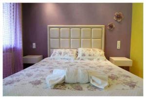 Ένα ή περισσότερα κρεβάτια σε δωμάτιο στο Maniatis Garden