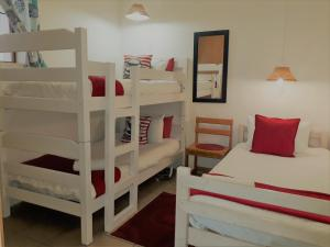 A bunk bed or bunk beds in a room at Oom Piet Accommodation