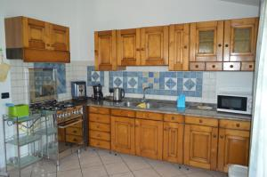 A kitchen or kitchenette at Le Magnolie