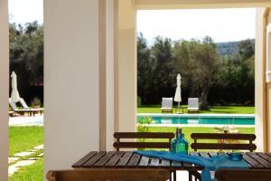 Πισίνα στο ή κοντά στο Olivastro Villa