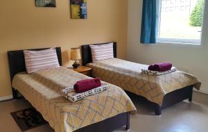 A bed or beds in a room at Nord Fish Apartments