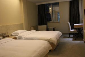 Tiga Hotel