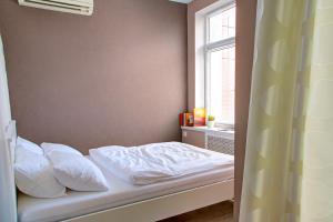 Кровать или кровати в номере Ufa Kremlin