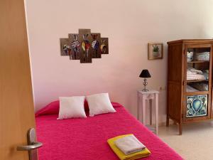 Katil atau katil-katil dalam bilik di Dúplex en Calle Acicatena