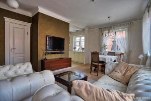 Ein Sitzbereich in der Unterkunft Royal Warsaw Apartment