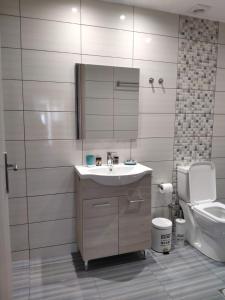 A bathroom at Brand New Studio by the Beach
