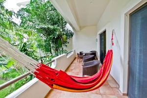 A balcony or terrace at Palmar del Sol by Riviera Maya Suites