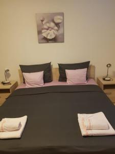 A bed or beds in a room at Pavlic Apartments