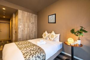 A bed or beds in a room at Mr. Kinjo in MIHARA