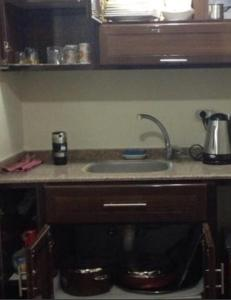 A kitchen or kitchenette at Two - Bedroom Apartment at Hawaiian , Ain El Sokhna