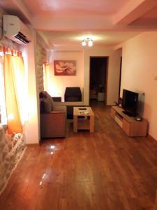 Телевизор и/или развлекательный центр в Apartments Ana