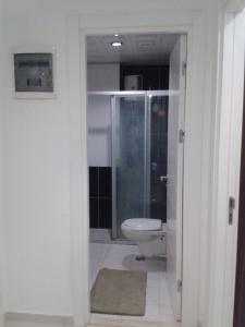 Ванная комната в Sunlight Residence