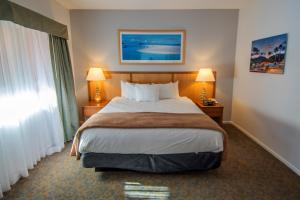 A bed or beds in a room at San Luis Bay Inn by Wyndham Vacations