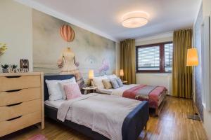 Кровать или кровати в номере Prague deluxe apartment
