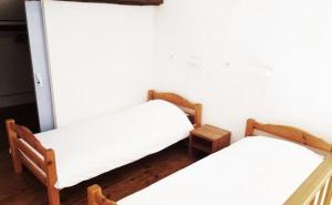 A bed or beds in a room at Domaine Hemmitage