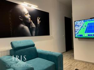 Un televizor și/sau centru de divertisment la Apartamente Iris