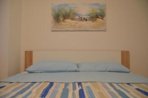 Postelja oz. postelje v sobi nastanitve Garden View Apartments