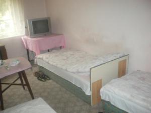A bed or beds in a room at Pannónia Vendégház