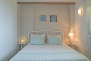 A bed or beds in a room at Villa Vivima