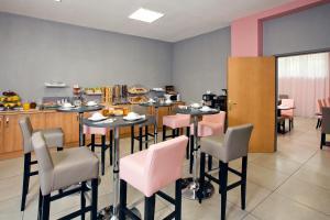 Restaurant o un lloc per menjar a Séjours & Affaires Lyon Park Avenue