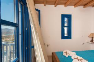 Un ou plusieurs lits dans un hébergement de l'établissement Mykonos Pro-care Suites
