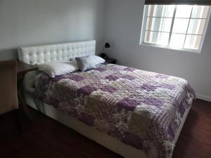 Un ou plusieurs lits dans un hébergement de l'établissement Swan Boutique Apartment