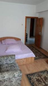A bed or beds in a room at Apartment Adrian