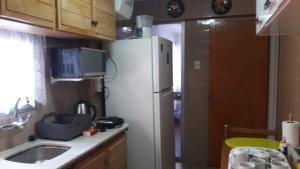 A kitchen or kitchenette at Hermoso Apartamento En el Centro de Salto