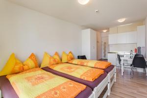 A bed or beds in a room at Anstatthotel.ch Hochdorf