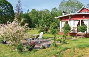 A garden outside Three-Bedroom Holiday Home in Fagelmara