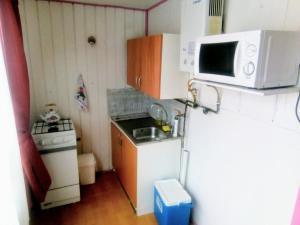 A kitchen or kitchenette at Refugio Urbano