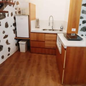 A kitchen or kitchenette at Marabia Loft
