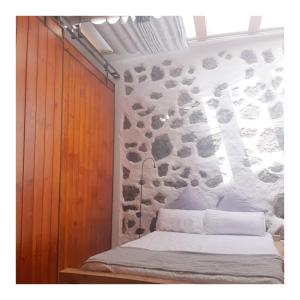 A bed or beds in a room at Marabia Loft