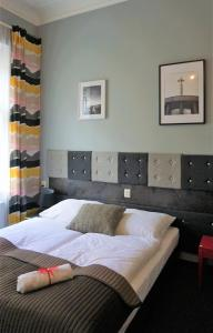 A bed or beds in a room at Expolis Residence - Rooms & Apartments