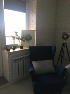 Et opholdsområde på Apartment Zhemchuzhina Viktorii