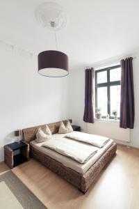 Ein Bett oder Betten in einem Zimmer der Unterkunft Ferienwohnung Leipzig-Zentrum
