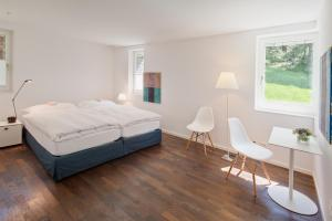 A bed or beds in a room at Chalet Altesse - Premium Apartments